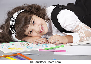 cute girl happy with her colorful drawing