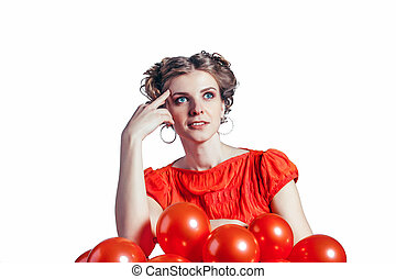 Cute girl has reflected on a white background in  red dress with balloons.