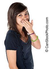 Cute girl hiding her braces - Cute Hispanic teenage girl...