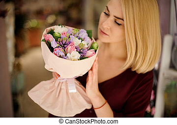Cute girl holding a beautiful and colorful bouquet