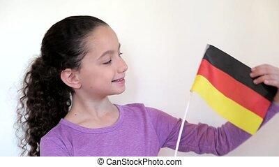 Cute girl holding flag of Germany - Shot of Cute girl...