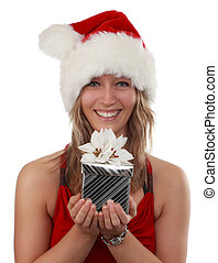 beautiful young woman holding a silver Christmas gift, isolated on white