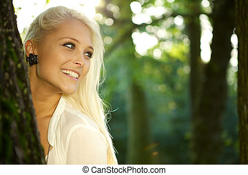 Cute girl in a green park