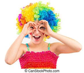 Cute girl in clown wig using her hands as binoculars