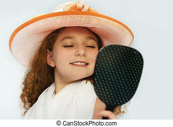 Cute girl in fancy hat