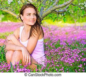 Cute girl in floral garden