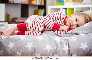 Cute girl in pajama sleeping in bed