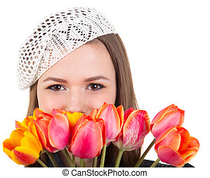 Cute girl in parisian style with tulip flowers