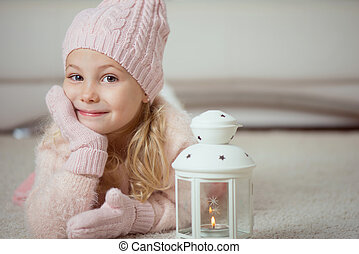 Cute girl in pink celebrating Christmas