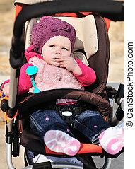 cute girl in stroller