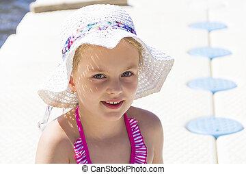 Cute girl in white hat
