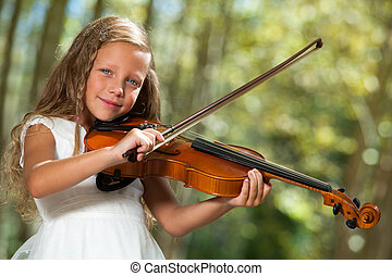 Cute girl in white playing violin outdoors. - Close up...