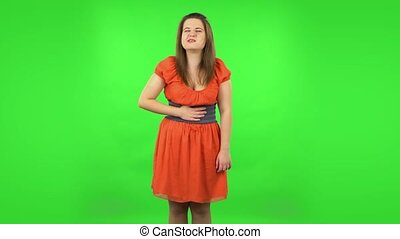 Cute girl is feeling very bad, her stomach hurting . Green screen