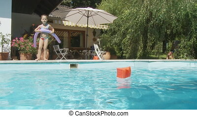 cute girl jumping into pool slo mo - little girl jumping...
