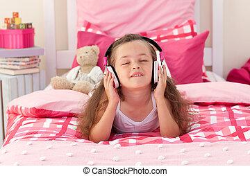 Cute girl listening music with headphones