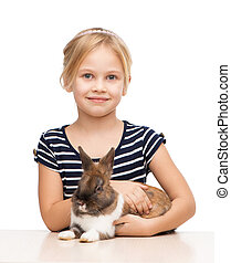Cute girl looking at camera with bunny