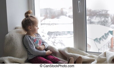 Cute girl looking out the window
