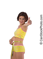 Cute girl measuring her small waist