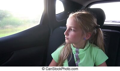 cute girl moving in car