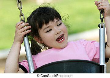 Cute girl on swing