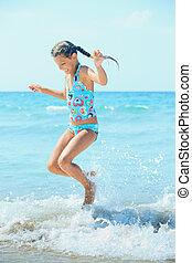Cute girl on the beach