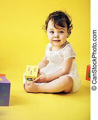 Cute girl playing toy bricks