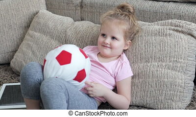 Cute girl playing with ball