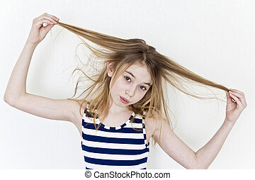 Cute girl playing with blond long hair on white
