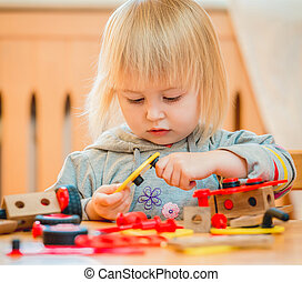 cute girl playing with constructor