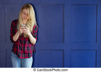 Cute Girl playing with her Phone