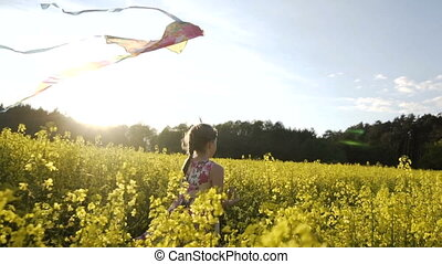 Cute Girl Plays with Kite