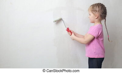 Cute girl priming a wall