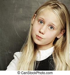Cute girl - pupil at school