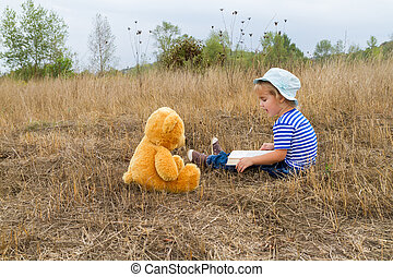 Cute girl reading book Teddy bear