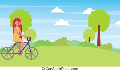 cute girl riding bicycle in the natural landscape