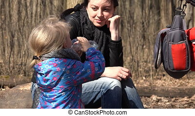 Cute Girl Run in the Forest with Mother Drinks a Water