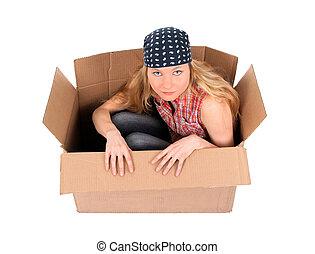Cute girl sitting in a cardboard box