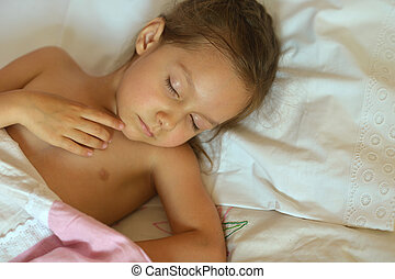 Cute girl sleeping in bed