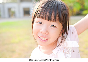 cute girl smile happily