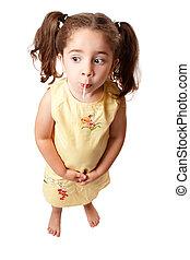 Cute girl sucking on a lollipop candy