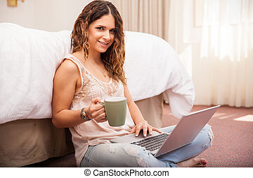 Cute girl using a laptop computer