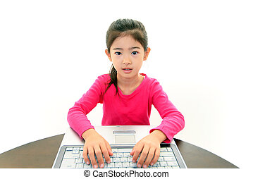Cute girl using a laptop