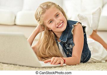 cute girl using computer