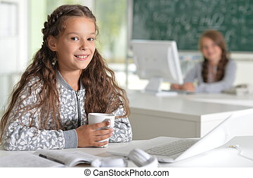 cute girl using laptop computer