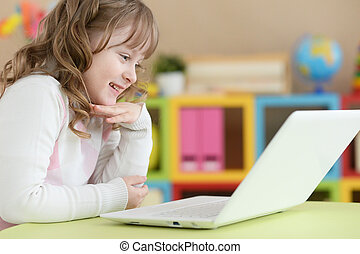 cute girl using laptop