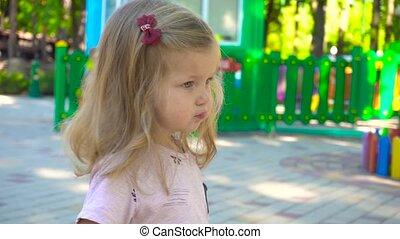 Cute girl walking in amusement park - Cute little girl...