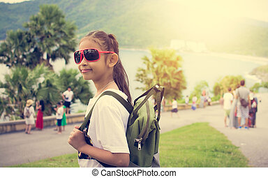 Cute girl with backpack at promthep cape. - Cute girl with...