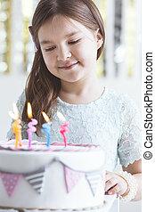 Cute girl with birthday cake