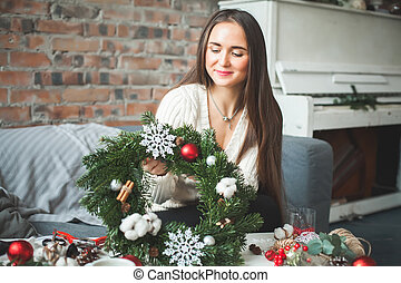 Cute Girl with Christmas Decorations at Home