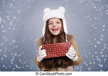 Cute girl with christmas present
